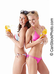 Beautiful girls - Two young attractive girl with a cocktail...