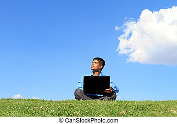 businessman with laptop - young businessman sitting down on...