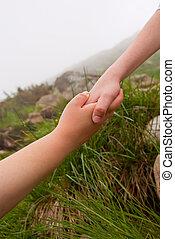 Reaching hands - help of friend