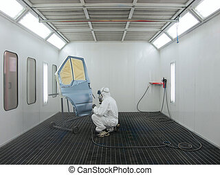painter works in a spray booth - The image of painter works...