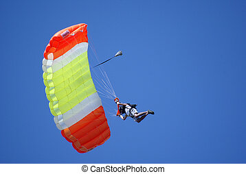 paragliding - man on paraglider in the sky