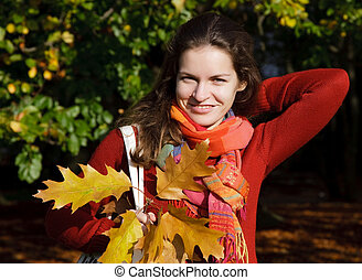 Young woman in autumn park - Autumn portrait of young...