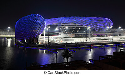 Yas Marina Hotel illuminated at night. Abu Dhabi, United...