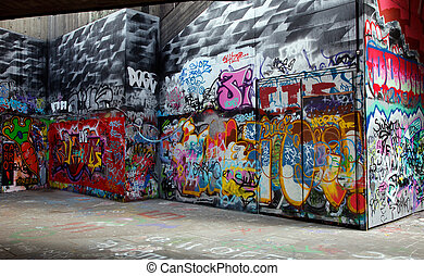 graffiti - Gray walls painted with bright colorful graffiti