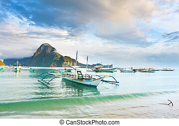 Tropical lagoon - Traditional philippine boats bangka in...