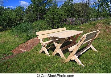 garden furniture near old pond