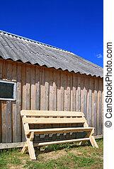 wooden bench near wooden wall