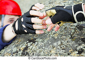 climber reach out for help focus on hands