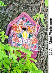 Homemade painted colorful wooden bird house
