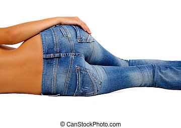 Girl in blue jeans - Topless girl in blue jeans laying on...