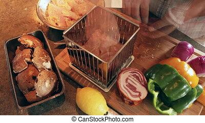 Preparing mini-kebabs. - Cooking mini kebabs or spedini in...