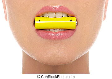 Woman holding battery in his mouth isolated on white