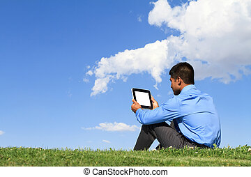 businessman with digital tablet - young businessman sitting...