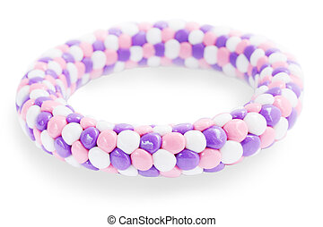 Plastic bracelet in the lilac tones on the white