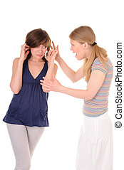 Quarrel - One young woman is shouting to another girl on...