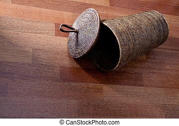wicker basket on the wooden floor