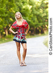 Young blond woman outdoor on a street - Full length portrait...