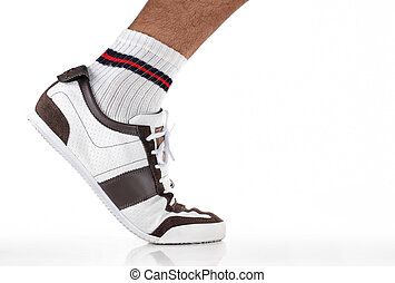 foot step - feet wearing sport shoes walking