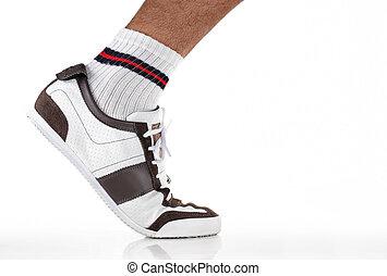foot step - feet wearing sport shoes walking