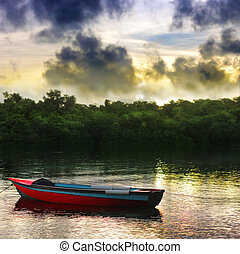 Rowboat - A single red rowboat on a beautiful lake with...