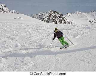 The woman is skiing at a ski resort