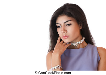 Beautiful young woman with pearl jewelry studio shot