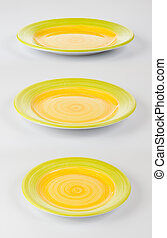 Set of color round plates or dishes on white background