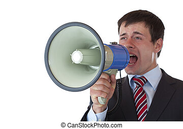 Young businessman shouts loudly into megaphone