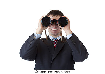 Smiling businessman looks through binoculars and espies...