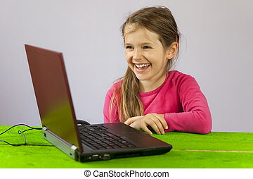 seven-year old girl with laptop