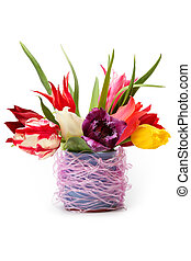 multicolored tulips in a vase on a white background