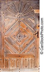Old wooden door -  vintage padlock on an old wooden door