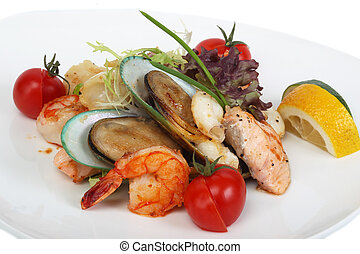 Delicatessen dish with tiger shrimps, mussels