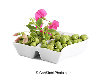 Green Peas and a branch with flowers on a white background