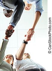 Two handshakes - Below angle of two pairs of successful...