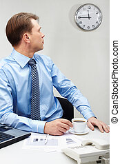 End of coffee break - Portrait of young businessman sitting...