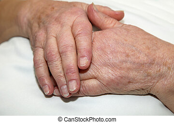 Care - Hands of a care-dependent person.