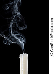 candle wax on a black background - Smoke and extinguished...