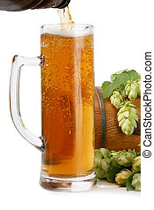 Plant hops, keg and a glass of beer isolated on white...
