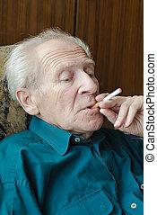 Senior Man Smoking - thoughtful senior man smoking...