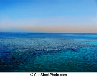 Coral island. Red sea. Sunset