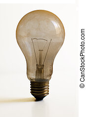 Dusty burned out light bulb - Old technology and wasting...