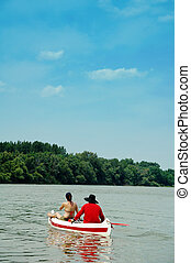 People in canoe - Sport couple, woman and man in a canoe...