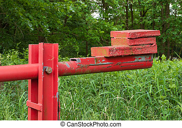 counterweight at the end of a red barrier