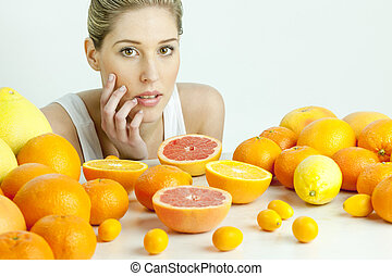 portrait of young woman with citrus fruit