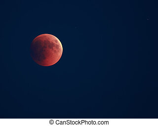 Lunar eclipse 15.06.2011. Red disc of moon over dark sky.