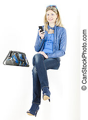 sitting woman with mobile phone and handbag