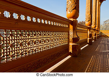 Carved wood rail and column in summer pavilion. Tajikistan