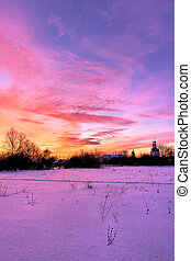 Winter sunset at russian countryside