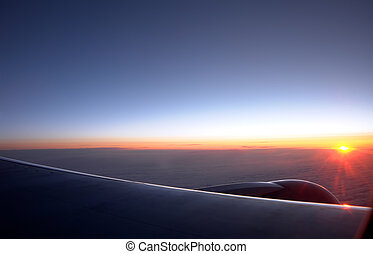Sunrise at an altitude of ten thousand meters